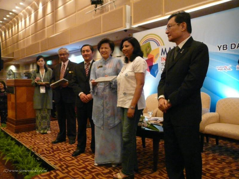 Receiving a memento from Minister of Tourism, Malaysia